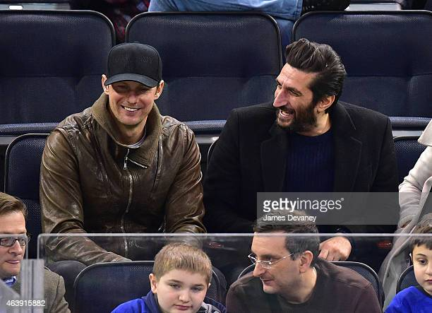 Alexander Skarsgard and Fares Fares attend Vancouver Canucks vs New York Rangers game at Madison Square Garden on February 19 2015 in New York City