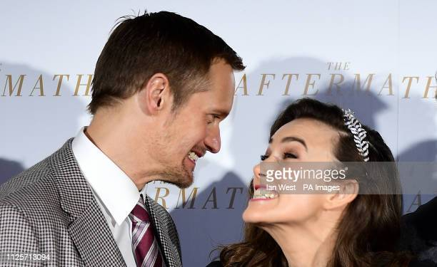 Alexander Skarsgard and Keira Knightley share a joke during the world premiere of The Aftermath held at the Picturehouse Central Cinema London