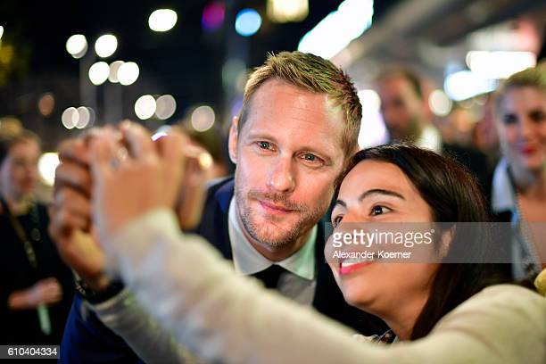 Alexander Skarsgard takes a selfie with a fan as he attends the 'War On Everyone' Premiere during the 12th Zurich Film Festival on September 25 2016...