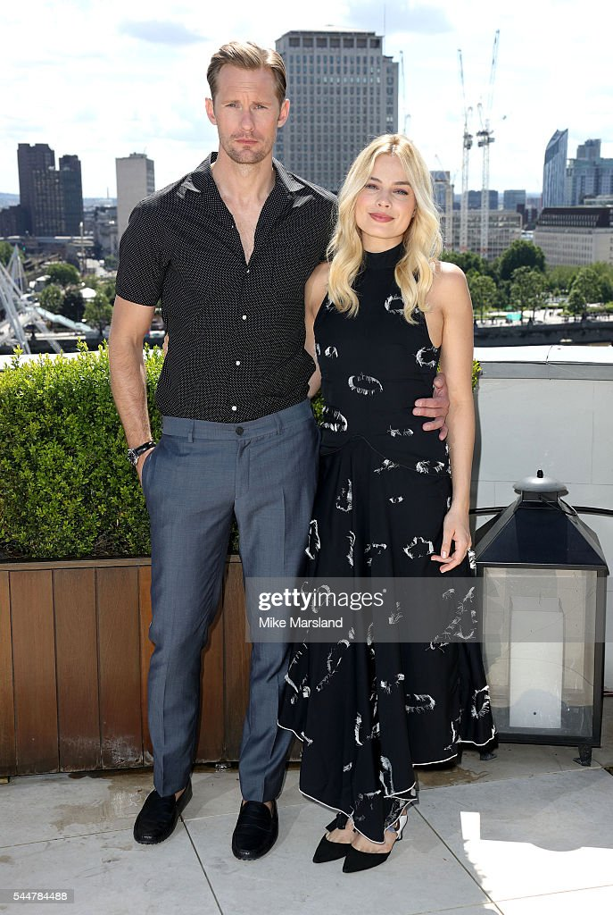 Alexander Skarsgrd and Margot Robbie attend a Photocall for the film 'The Legend Of Tarzan' at Corinthia London on July 4, 2016 in London, England.