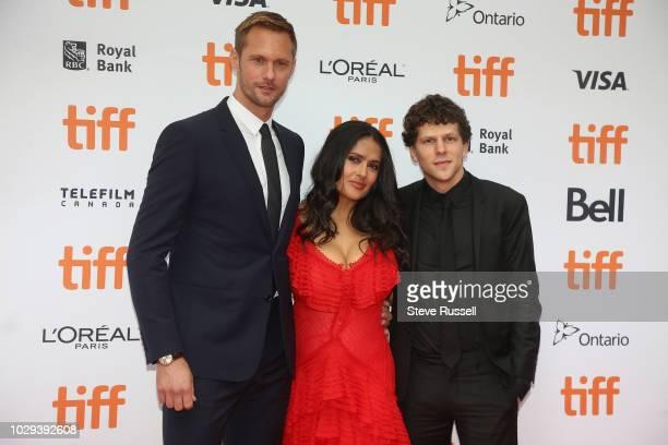 TORONTO ON SEPTEMBER 8 Alexander Skarsgård Salma Hayek and Jesse Eisenberg on the red carpet of the world premiere of the movie The Hummingbird...