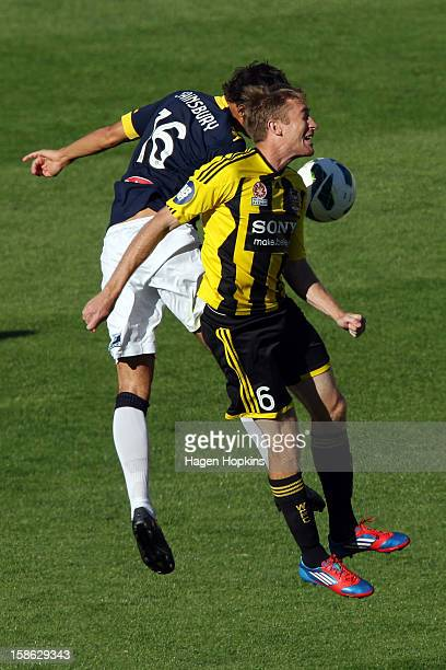 Alexander Smith of the Phoenix and Trent Sainsbury of the Mariners compete for a header during the round 12 ALeague match between the Wellington...
