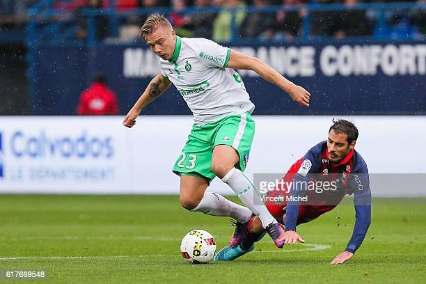 Alexander Soderlund of SaintEtienne and Nicolas Seube of Caen during the Ligue 1 match between SM Caen and AS SaintEtienne at Stade Michel D'Ornano...