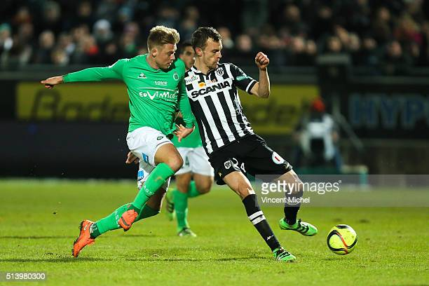 Alexander Soderlund of SaintEtienne and Romain Thomas of Angers during the French Ligue 1 match between Angers SCO v AS SaintEtienne at Stade...