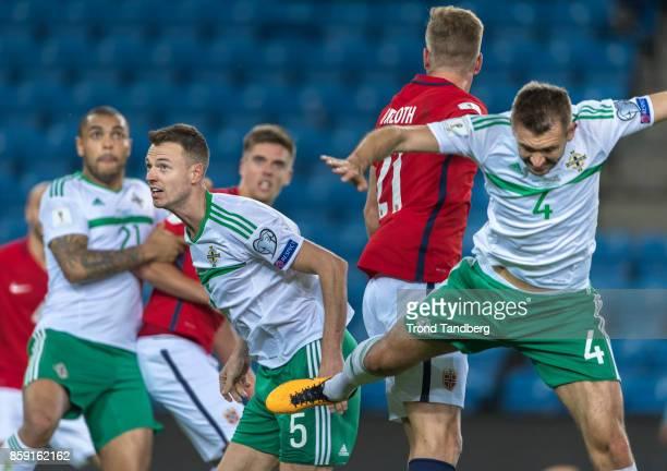 Alexander Soerloth of Norway Josh Magennis Jonny Evans Gareth McAuley of Northern Ireland during the FIFA 2018 World Cup Qualifier between Norway and...