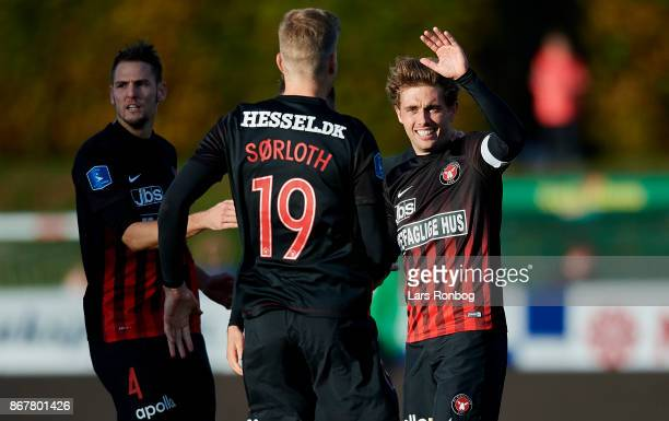 Alexander Sorloth and Jakob Poulsen of FC Midtjylland celebrate after scoring their second goal during the Danish Alka Superliga match between Lyngby...