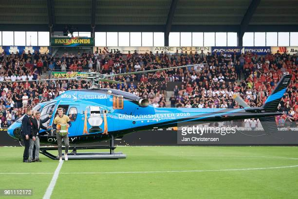 Alexander Sorloth and the trophy were flown into the stadium in a helicopter after the Danish Alka Superliga match between FC Midtjylland and AC...
