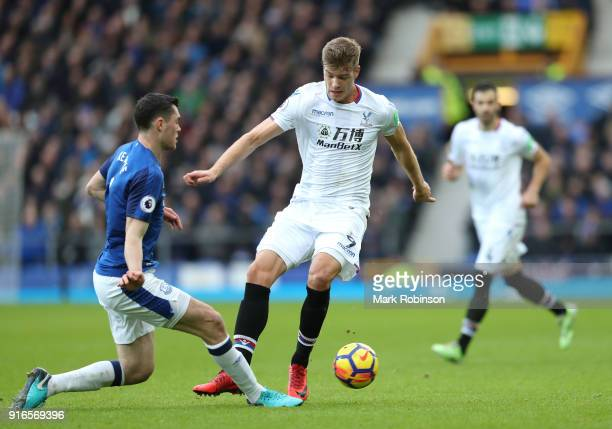 Alexander Sorloth of Crystal Palace and Michael Keane of Everton battle for the ball during the Premier League match between Everton and Crystal...