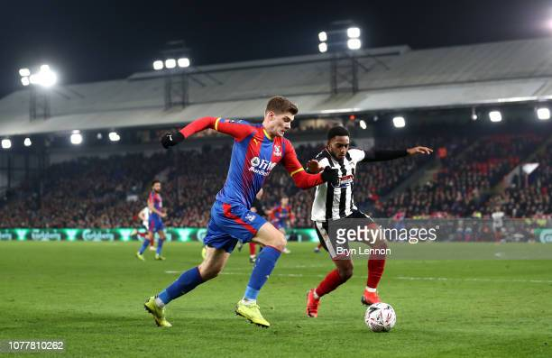 Alexander Sorloth of Crystal Palace battles for possession with Reece HallJohnson of Grimsby Town during the FA Cup Third Round match between Crystal...