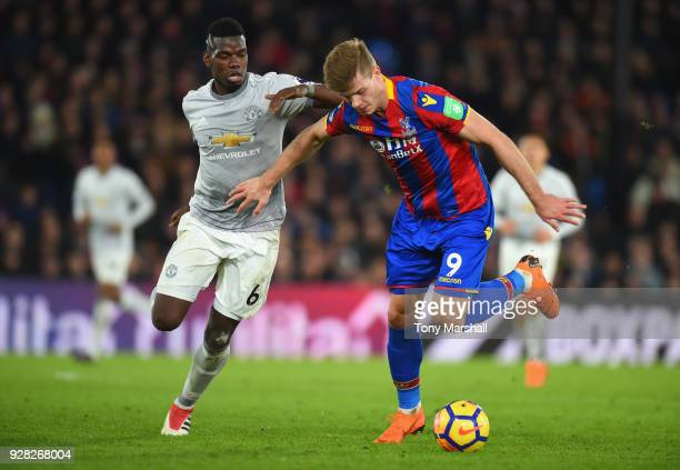 Alexander Sorloth of Crystal Palace holds off a challenge from Paul Pogba of Manchester United during the Premier League match between Crystal Palace...