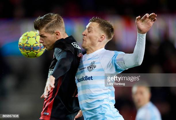Alexander Sorloth of FC Midtjylland and Andreas Holm of FC Helsingor compete for the ball during the Danish Alka Superliga match between FC...