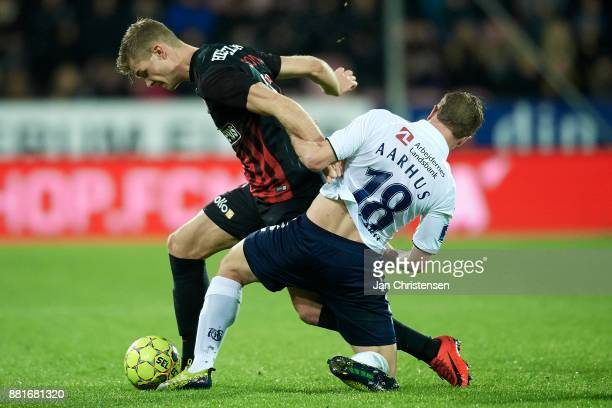 Alexander Sorloth of FC Midtjylland and Jesper Juelsgard of AGF Arhus compete for the ball during the Danish Alka Superliga match between FC...
