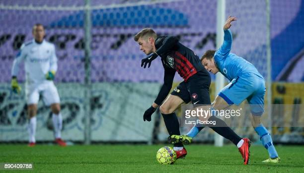 Alexander Sorloth of FC Midtjylland and Kasper Enghardt of Randers FC compete for the ball during the Danish Alka Superliga match between Randers FC...