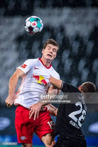 Alexander Sorloth of Leipzig and Matthias Ginter of Mönchengladbach head the ball during the Bundesliga match between Borussia Mönchengladbach and RB...