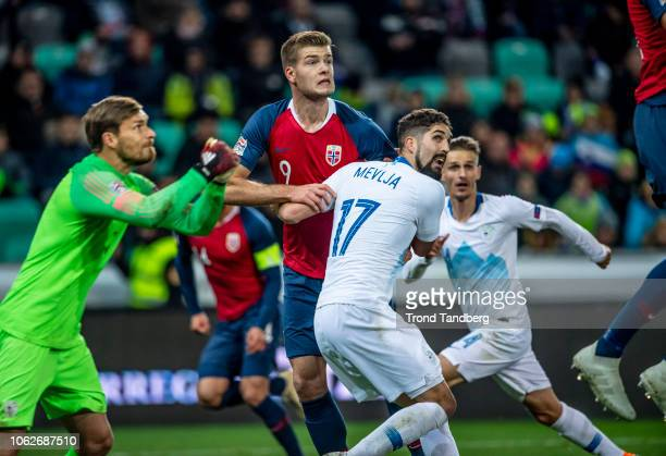 Alexander Sorloth of Norway Vid Belec Miha Mevlja Petar Stojanovic of Slovenia during the UEFA Nations League C group three match between Slovenia...