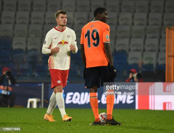 Alexander Sorloth of RB Leipzig celebrates after scoring their sides fourth goal as Demba Ba of Istanbul Basaksehir FK looks on during the UEFA...