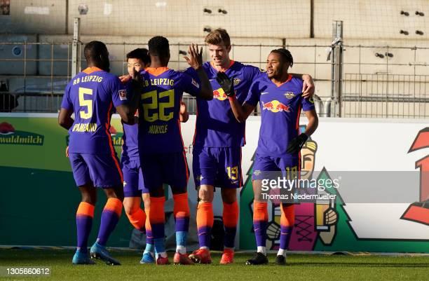 Alexander Sorloth of RB Leipzig celebrates with teammates Dayot Upamecano, Nordi Mukiele, and Christopher Nkunku after scoring his team's second goal...