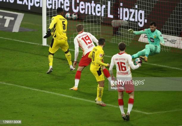 Alexander Sorloth of RB Leipzig scores their sides first goal past Roman Burki of Borussia Dortmund during the Bundesliga match between RB Leipzig...