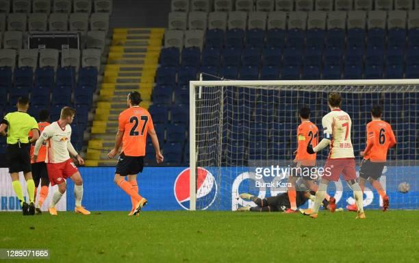 Alexander Sorloth of RB Leipzig scores their sides fourth goal past Mert Gunok of Istanbul Basaksehir FK during the UEFA Champions League Group H...