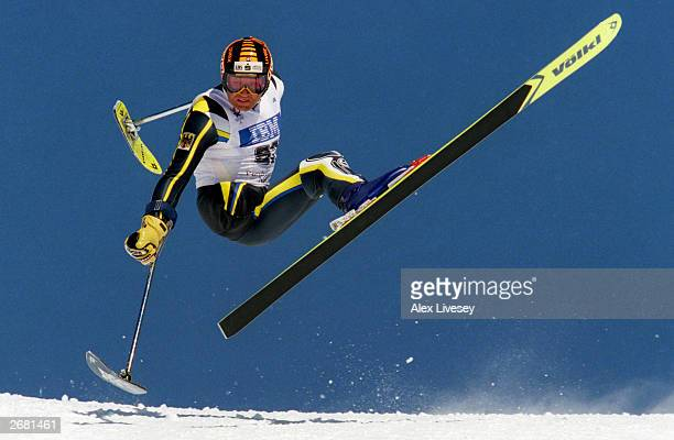 Alexander Spitz of Germany in action before he falls and breaks his leg during the Downhill LW2 Class on March 01 1998 at Winter Paralympics in...