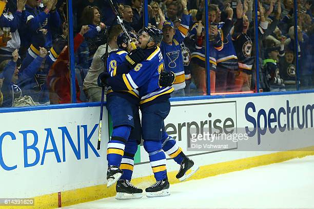 Alexander Steen and Paul Stastny of the St Louis Blues celebrate Steen's goal against the Minnesota Wild in the first period at the Scottrade Center...