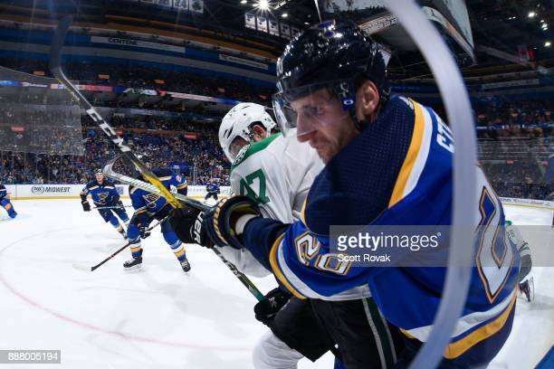 Alexander Steen of the St Louis Blues and Alexander Radulov of the Dallas Stars battle at Scottrade Center on December 7 2017 in St Louis Missouri