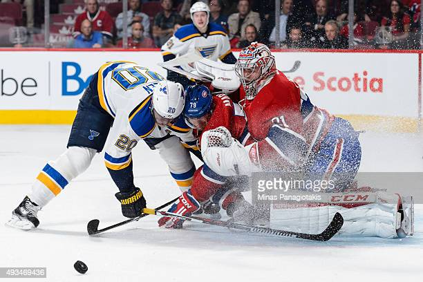 Alexander Steen of the St Louis Blues and Andrei Markov of the Montreal Canadiens crash into goaltender Carey Price during the NHL game at the Bell...