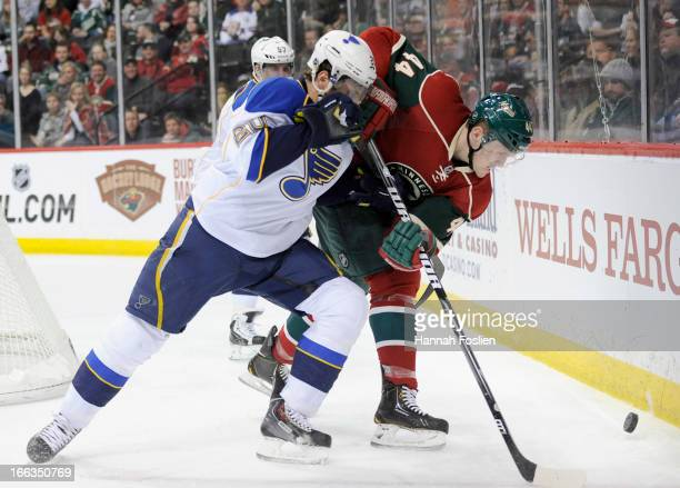 Alexander Steen of the St Louis Blues and Justin Falk of the Minnesota Wild go after the puck during the second period of the gmae on April 11 2013...