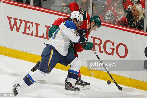 Alexander Steen of the St Louis Blues and Justin Falk of the Minnesota Wild battle for the puck near the boards during the game on April 11 2013 at...
