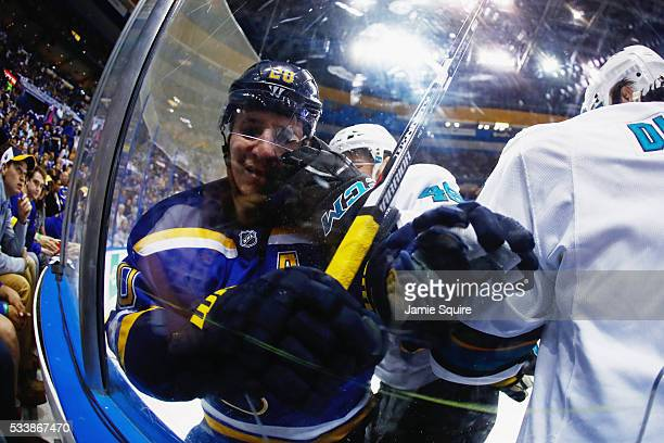 Alexander Steen of the St. Louis Blues and Tomas Hertl of the San Jose Sharks battle against the glass during the second period in Game Five of the...