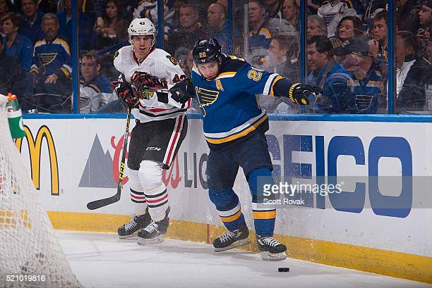 Alexander Steen of the St Louis Blues and Viktor Svedberg of the Chicago Blackhawks battle for the puck in Game One of the Western Conference...