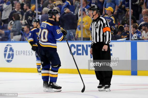 Alexander Steen of the St Louis Blues argues with referee Dan O'Rourke after a possible game winning overtime goal in Game Three of the Western...