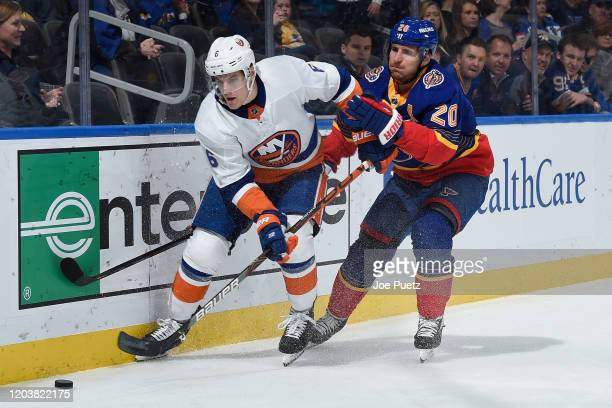 Alexander Steen of the St Louis Blues battles Ryan Pulock of the New York Islanders for the puck at Enterprise Center on February 27 2020 in St Louis...