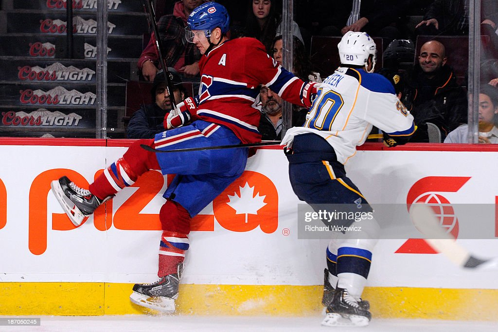 Alexander Steen #20 of the St. Louis Blues body checks Josh Gorges #26 of the Montreal Canadiens during the NHL game at the Bell Centre on November 5, 2013 in Montreal, Quebec, Canada. The Blues defeated the Canadiens 3-2 in a shootout.