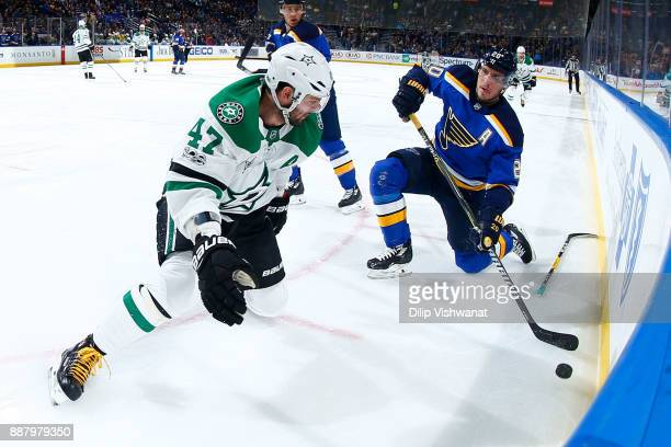 Alexander Steen of the St Louis Blues looks to pass the puck against Alexander Radulov of the Dallas Stars at Scottrade Center on December 7 2017 in...