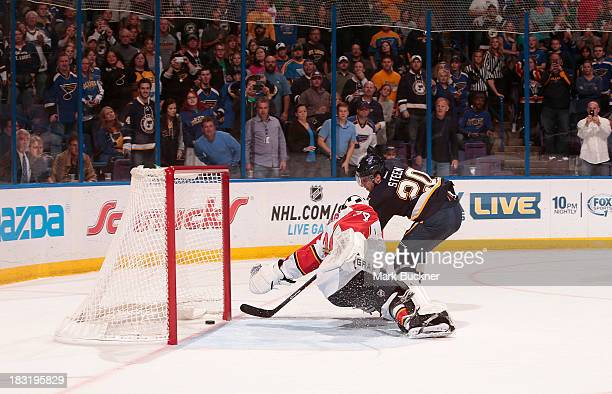 Alexander Steen of the St. Louis Blues scores on a penalty shot against Tim Thomas of the Florida Panthers in an NHL game on October 5, 2013 at...