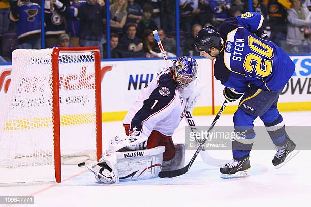 Alexander Steen of the St. Louis Blues scores the game-winning goal against Steve Mason of the Columbus Blue Jackets at the Scottrade Center on March...