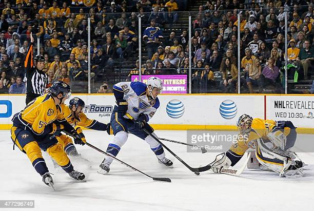 Alexander Steen of the St Louis Blues shoots the puck against goalie Pekka Rinne as Shea Weber and Roman Josi of the Nashville Predators defend at...