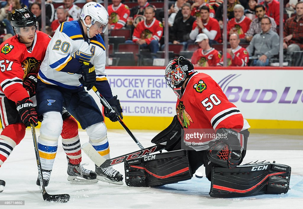 Alexander Steen #20 of the St. Louis Blues shoots the puck against goalie Corey Crawford #50 of the Chicago Blackhawks to score, as Trevor van Riemsdyk #57 follows, in the second period of the NHL game at the United Center on November 4, 2015 in Chicago, Illinois.
