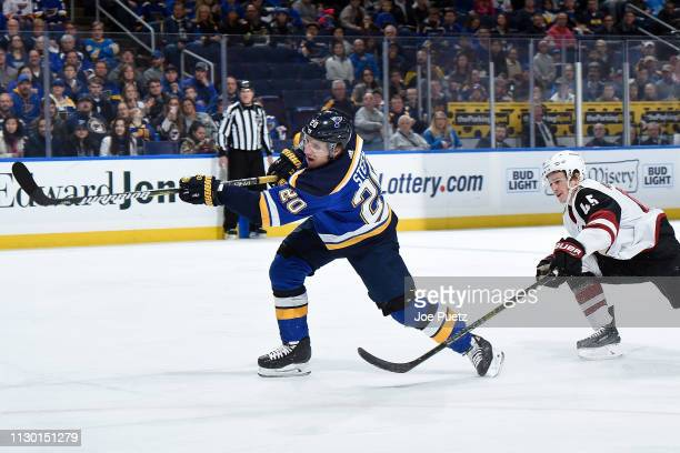 Alexander Steen of the St Louis Blues takes a shot as Josh Archibald of the Arizona Coyotes attempts to block at Enterprise Center on March 12 2019...