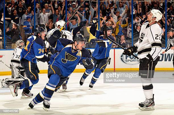 Alexander Steen, T.J. Oshie and David Backes of the St. Louis Blues celebrate as Trevor Lewis of the Los Angeles Kings looks on after Alex...