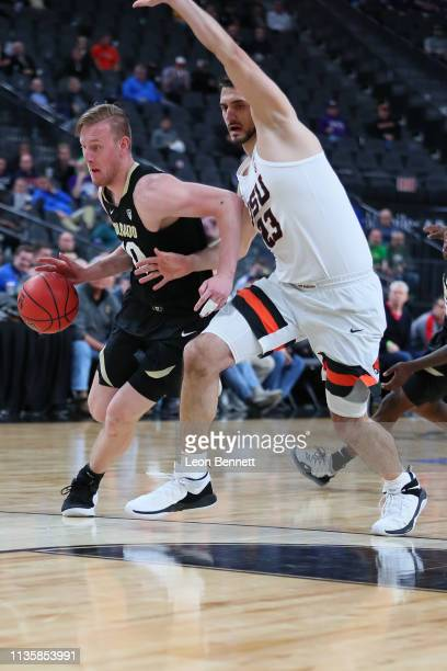 Alexander Strating of the Colorado Buffaloes handles the ball against Gligorije Rakocevic of the Oregon State Beavers during a quarterfinal game of...