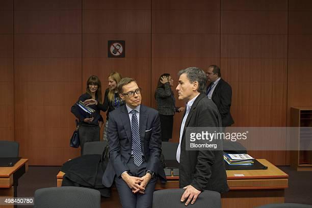 Alexander Stubb Finland's finance minister left speaks with Euclid Tsakalotos Greece's finance minister ahead of 2016 draft budget roundtable talks...