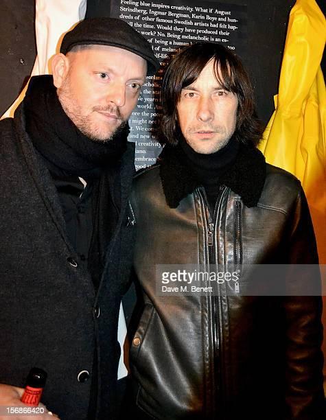 Alexander Stutterheim and Bobby Gillespie attend the launch of the Stutterheim Raincoats pop up shop in Shoreditch on November 22 2012 in London...