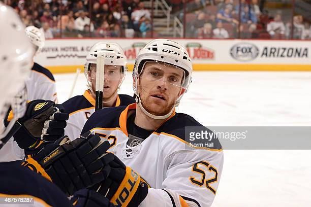 Alexander Sulzer and teammates of the Buffalo Sabres celebrate a goal against the Phoenix Coyotes at Jobingcom Arena on January 30 2014 in Glendale...