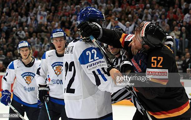 Alexander Sulzer of Germany and fight with Tommi Santala of Finland during the IIHF World Championship group A match between Germany and Finland at...