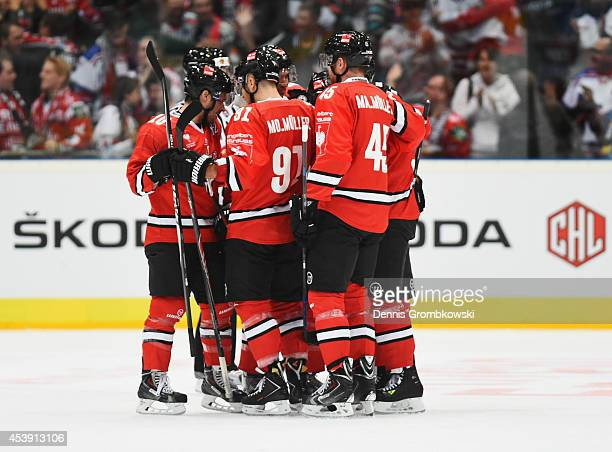 Alexander Sulzer of Koelner Haie celebrates with team mates after scoring  his team s first goal during ea88b67d565
