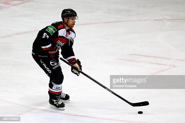 Alexander Sulzer of Koelner Haie leads the puck during the DEL Ice Hockey match between Koelner Haie and Augsburger Panther at Lanxess Arena on...