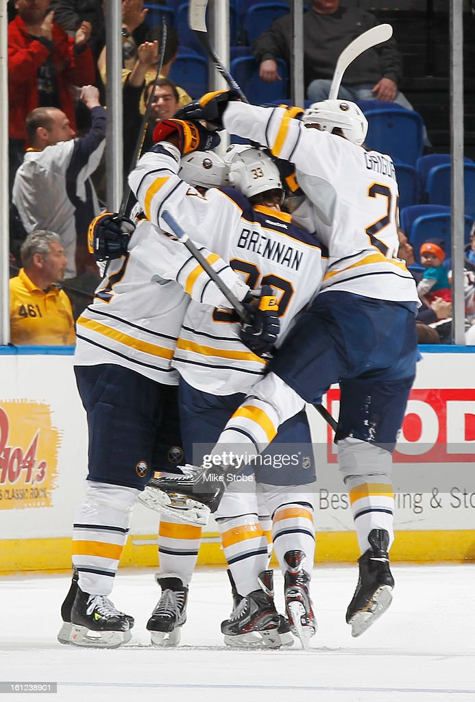 Alexander Sulzer #52 of the Buffalo Sabres is congratulated by his teammates after his 3rd period goal at Nassau Veterans Memorial Coliseum on February 9, 2013 in Uniondale, New York. The Sabers defeated the Islanders 3-2.