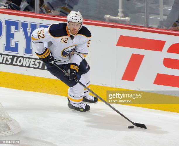 Alexander Sulzer of the Buffalo Sabres plays the puck behind the net during second period action against the Winnipeg Jets at the MTS Centre on...